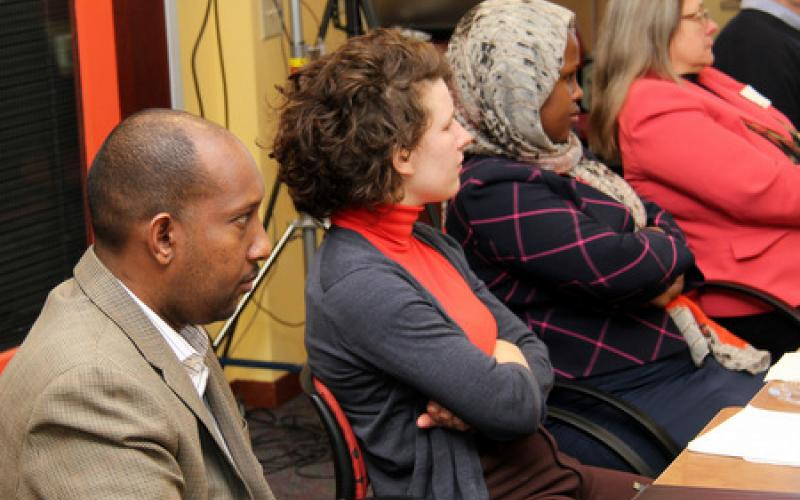 Participants listen to Police Chief of Minneapolis, Jeneé Harteau (not shown)