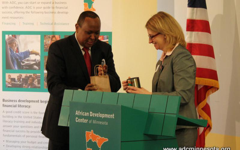 Hussein Samatar gives Adriana Abariotes with a token of appreciation