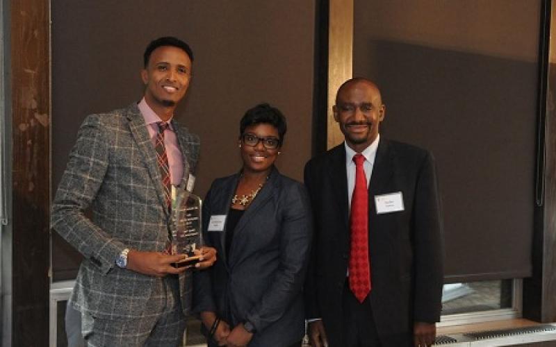 Owner of Family Care Transportation, LLC, Minneapolis with Nasibu Sareva and Commissioner Shawntera Hardy