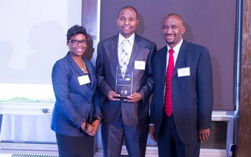 Owner of Ultimate Health Care, Inc, Minneapolis with Nasibu Sareva and Commissioner Shawntera Hardy