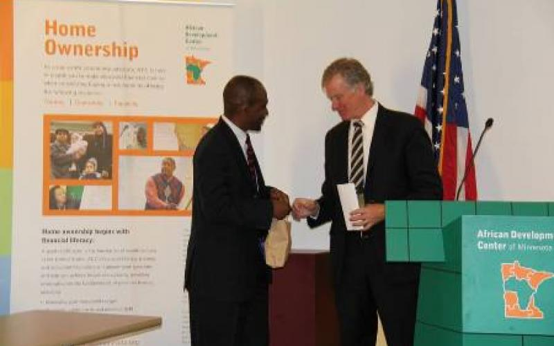 African Development Center of MN executive director Nasibu Sera and Mayor Chris Coleman shake hands