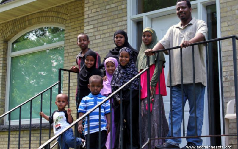 Somali family outside their newly-purchased home in St. Cloud, MN