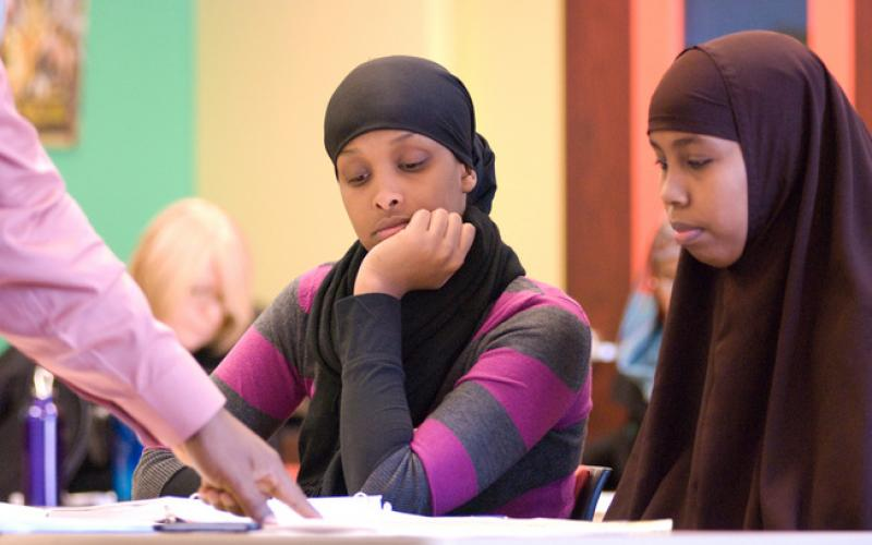 African women wearing Hijab study information about financial education