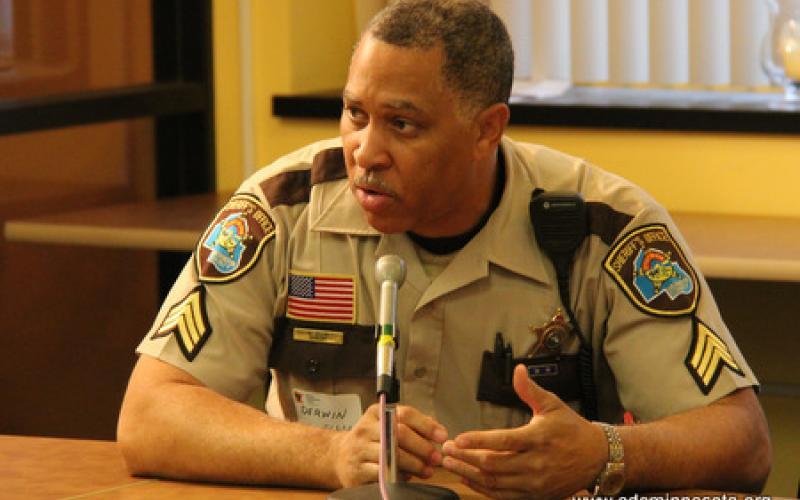 A Hennepin County Sherrif's Department Sergeant Derwin Ellis speaks to group