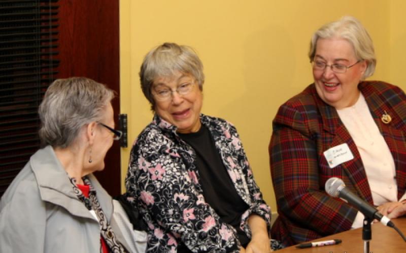 Participants laugh at table