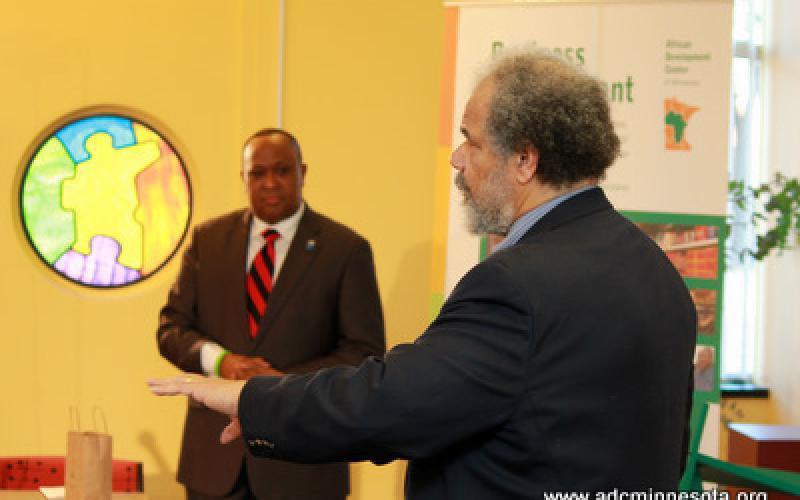 William Green speaks. Hussein Samatar looks on.