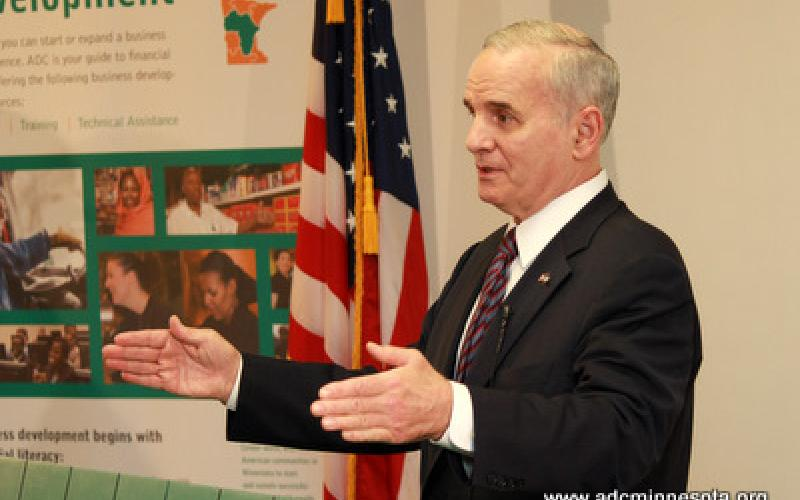 Minnesota Governor Mark Dayton gestures at the podium