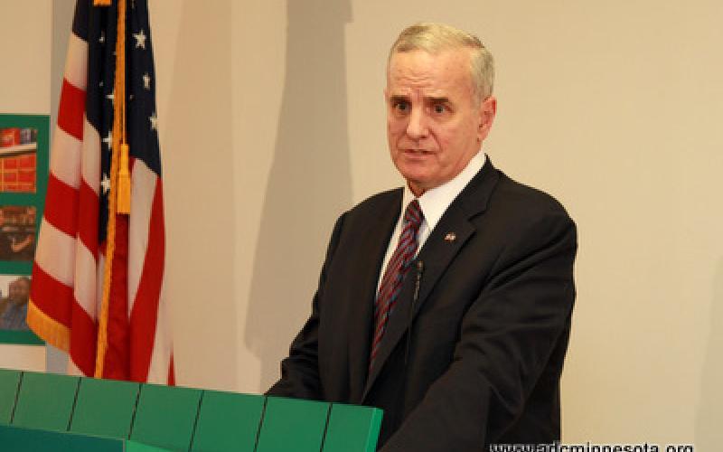 Minnesota Governor Mark Dayton at the podium