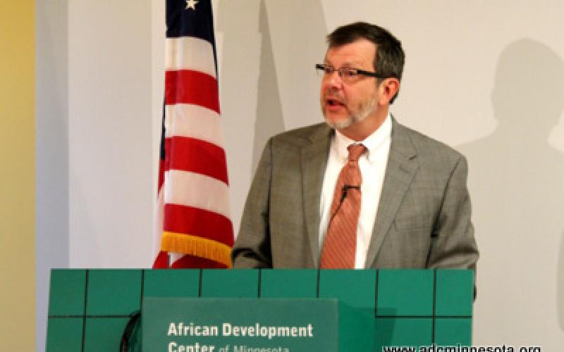 Eric W. Kaler, President of the University of Minnesota speaks at the podium