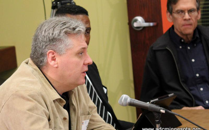 a participant speaks at the ADC Business Breakfast Roundtable February 2012