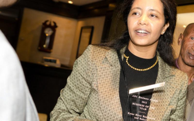 A representative of Business of the Year award winner Katar River Restaurant & Bakery