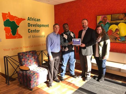 Regional ADC manager Abdirahin Hussen poses with members of Wilmar Chamber of Commerce